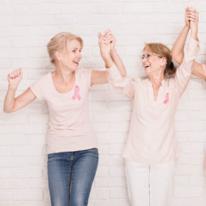 Two Breast Cancer Survivors holding hands